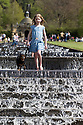 04/05/15<br /> <br /> Isabella Coleman (9) and her cavalier King Charles, Emily, cool-off in the Cascade as people flock to enjoy the Bank Holiday Monday weather in the gardens of Chatsworth House, in the Derbyshire Peak District. <br /> <br /> All Rights Reserved - F Stop Press.  www.fstoppress.com. Tel: +44 (0)1335 418629 +44(0)7765 242650