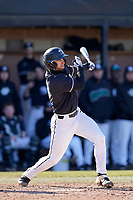 Jason Matthews (11) of the University of South Carolina Upstate Spartans gets a hit in the fourth inning of a game against the University of Toledo Rockets on Saturday, February 20, 2021, at Cleveland S. Harley Park in Spartanburg, South Carolina. Upstate won, 5-1. (Tom Priddy/Four Seam Images)