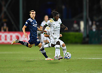 LAKE BUENA VISTA, FL - AUGUST 01: Yimmi Chará #23 of the Portland Timbers runs with the ball as James Sands #16 of New York City FC looks on during a game between Portland Timbers and New York City FC at ESPN Wide World of Sports on August 01, 2020 in Lake Buena Vista, Florida.
