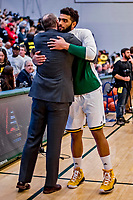 16 March 2019: University of Vermont Catamount Forward Anthony Lamb, a Junior from Toronto, Ontario, gives his coach a hug prior to facing the UMBC Retrievers in the America East Championship Game at Patrick Gymnasium in Burlington, Vermont. Lamb was named the Most Outstanding Player for the second time in his career with a game-high 28 points and nine rebounds as the Catamounts defeated the Retrievers 66-49 to avenge their loss against the same team in last years' Championship Game. Mandatory Credit: Ed Wolfstein Photo *** RAW (NEF) Image File Available ***