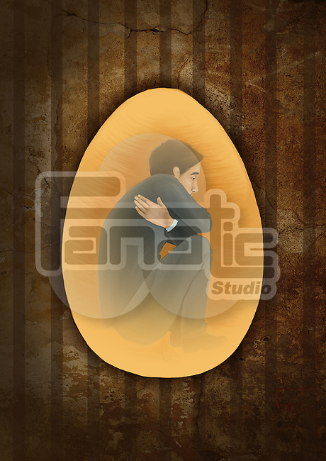 Side view of a man crouching inside egg depicting the concept of prisoner of mind