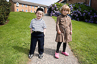 Two Hasidic children pose outside their rented house. Hasidic families stay in Pentre Jane Morgan university accommodation when they holiday in Aberystwyth. Every other day, bread, milk and other supplies are brought from Kosher shops in London and resold from one of the rented houses on the campus.