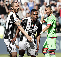 Calcio, Serie A: Juventus vs Crotone. Torino, Juventus Stadium, 21 maggio 2017.<br /> Juventus' Alex Sandro, right, is hugged by his teammate Leonardo Bonucci after scoring during the Italian Serie A football match between Juventus and Crotone at Turin's Juventus Stadium, 21 May 2017. Juventus defeated Crotone 3-0 to win the sixth consecutive Scudetto.<br /> UPDATE IMAGES PRESS/Isabella Bonotto