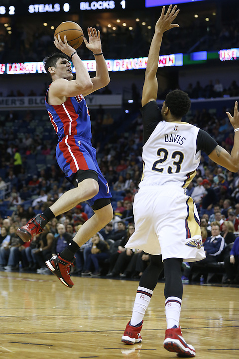 Detroit Pistons forward Ersan Ilyasova (23) shoots over New Orleans Pelicans forward Anthony Davis (23) during the second half of an NBA basketball game Thursday, Jan. 21, 2016, in New Orleans. The Pelicans won 115-99. (AP Photo/Jonathan Bachman)