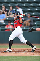 Josh Jung (15) of the Hickory Crawdads follows through on his swing during a game against the Kannapolis Intimidators at L.P. Frans Stadium on July 16, 2019 in Hickory, North Carolina. The Crawdads defeated the Intimidators 5-4. (Tracy Proffitt/Four Seam Images)