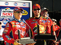 Feb 08, 2009; Daytona Beach, FL, USA; NASCAR Sprint Cup Series driver Martin Truex Jr (right) celebrates qualifying first with Mark Martin (left) who qualified second for the Daytona 500 at Daytona International Speedway. Mandatory Credit: Mark J. Rebilas-