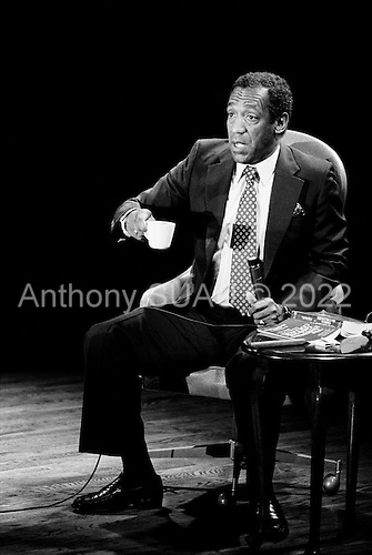 """Denver Colorado<br /> USA<br /> June 10, 1983<br /> <br /> Comedian Bill Cosby performs at McNichols Sports Arena. <br /> <br /> William Henry """"Bill"""" Cosby, Jr. (born July 12, 1937) is an American comedian, actor, author, television producer, educator, musician and activist. A veteran stand-up performer, he got his start at various clubs, then landed a starring role in the 1960s action show, I Spy. He later starred in his own series, the situation comedy The Bill Cosby Show, in 1969. He was one of the major characters on the children's television series The Electric Company for its first two seasons, and created the educational cartoon comedy series Fat Albert and the Cosby Kids, about a group of young friends growing up in the city. Cosby has also acted in a number of films.<br /> <br /> During the 1980s, Cosby produced and starred in what is considered to be one of the decade's defining sitcoms, The Cosby Show, which aired eight seasons from 1984 to 1992. The sitcom highlighted the experiences and growth of an upper-middle-class African-American family. He also produced the spin-off sitcom A Different World, which became second to The Cosby Show in ratings. He starred in the sitcom Cosby from 1996 to 2000 and hosted Kids Say the Darndest Things for two seasons.<br /> <br /> He has been a sought-after spokesman, and has endorsed a number of products, including Jell-O, Kodak film, Ford, Texas Instruments, and Coca-Cola, including New Coke. In 2002, scholar Molefi Kete Asante included him in his book, the 100 Greatest African Americans."""