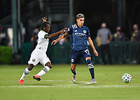 LAKE BUENA VISTA, FL - AUGUST 01: Jesús Medina #19 of New York City FC passes away from Diego Chará #21 of the Portland Timbers during a game between Portland Timbers and New York City FC at ESPN Wide World of Sports on August 01, 2020 in Lake Buena Vista, Florida.