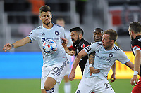 WASHINGTON, DC - MAY 13: Gaston Gimenez #30 of Chicago Fire and Robert Beric #27 of Chicago Fire battles for the ball with Junior Moreno #5 of D.C. United during a game between Chicago Fire FC and D.C. United at Audi FIeld on May 13, 2021 in Washington, DC.