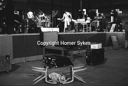 """Paul and Linda McCartney Wings Tour 1975.  Toddler Stella McCartney lies on the floor sucking her thumb waiting for her parents during a rehearsal  at Elstree  London, England. The photographs from this set were taken in 1975. I was on tour with them for a children's """"Fact Book"""". This book was called, The Facts about a Pop Group Featuring Wings. Introduced by Paul McCartney, published by G.Whizzard. They had recently recorded albums, Wildlife, Red Rose Speedway, Band on the Run and Venus and Mars. I believe it was the English leg of Wings Over the World tour. But as I recall they were promoting,  Band on the Run and Venus and Mars in particular."""
