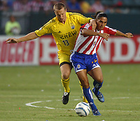 September 3, 2005 Photo by Matt A. Brown/ISI.Chivas USA (15) Juan Francisco Palencia fights off  Columbus Crew's (13) Mark Schulte for the ball in the first half.
