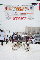 Wade Marrs and team leave the ceremonial start line at 4th Avenue and D street in downtown Anchorage during the 2013 Iditarod race. Photo by Jim R. Kohl/IditarodPhotos.com