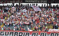 BOGOTÁ -COLOMBIA, 13-04-2014. Seguidores de Santa Fe alientan a su squipo durante el encuentro entre Independiente Santa Fe y Atlético Huila por la fecha 17 de la Liga Postobón  I 2014 disputado en el estadio Nemesio Camacho El Campín de la ciudad de Bogotá./ Supporters of Santa Fe encourage their team during the match between Independiente Santa Fe and Atletico Huila for the 17th date of the Postobon  League I 2014 played at Nemesio Camacho El Campin stadium in Bogotá city. Photo: VizzorImage/ Gabriel Aponte / Staff
