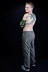 Young danish girl with dragon tattoo on back, stomach and upper left arm.<br /> From the Kolding Tattoo Convention, Denmark