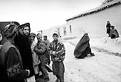 Northern Afghanistan <br /> October 2001<br /> <br /> 31 year old American John Weaver who works for Shelter for Life walks in the street near the Nowabad refugee camp