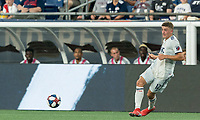 FOXBOROUGH, MA - JUNE 29: Justin Rennicks #12 passes the ball during a game between Houston Dynamo and New England Revolution at Gillette Stadium on June 29, 2019 in Foxborough, Massachusetts.