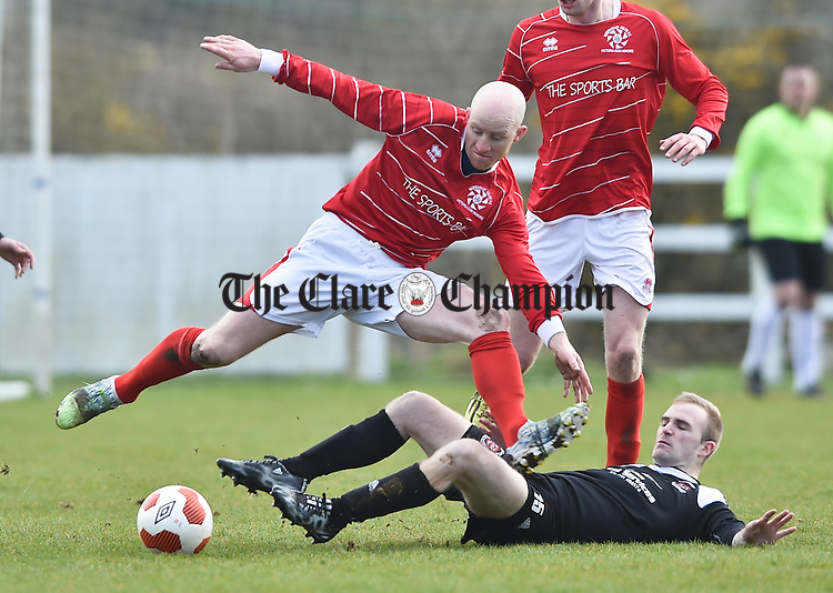 Alan Brigdale of Newmarket Celtic in action against David Donnan of Janesboro during their Munster League Champions Trophy final at The County Grounds, Doora. Photograph by John Kelly.