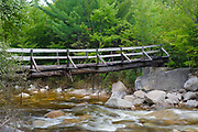 Side view of the Thoreau Falls Trail bridge days after Tropical Storm Irene in 2011. This bridge crosses the East Branch of the Pemigewasset River at North Fork Junction in the Pemigewasset Wilderness of New Hampshire.