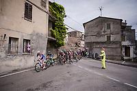 peloton rolling through town<br /> <br /> Stage 8: Tortoreto Lido to Pesaro (239km)<br /> 102nd Giro d'Italia 2019<br /> <br /> ©kramon