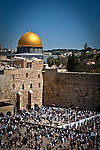 Jewish worshipers pray at the wailing wall Judaism most Holy site in Jerusalem Thursday March 28 2013. Thousands of Jewish worshipers gathered in Jerusalem to take part in  the tri-annual blessing of the Jewish people by members of the Jewish priestly caste at the Wailing Wall in Jerusalem. Jews named Cohen, considered descendants of the Temple's high priest, have the special duty of blessing the congregation three times a year.  Photo by Eyal Warshavsky.