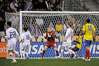 Goalkeeper Brad Guzan (18) of the United States (USA) encourages the team. The men's national teams of the United States (USA) and Colombia (COL) played to a 0-0 tie during an international friendly at PPL Park in Chester, PA, on October 12, 2010.