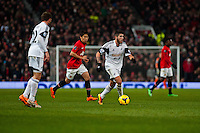 Saturday 11 January 2014 Pictured: Alejandro Pozuelo takes the ball forward for Swansea<br /> Re: Barclays Premier League Manchester Utd v Swansea City FC  at Old Trafford, Manchester