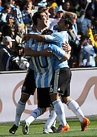 Gonzalo Hinguain, Linel Messi, and Sergio Aguero celebrate the third of Hinguain's goals on the day. Argentina defeated South Korea, 4-1, in both teams' second match of play in Group B of the 2010 FIFA World Cup. The match was played at Soccer City in Johannesburg, South Africa June 17th.