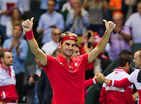 Switserland, Genève, September 20, 2015, Tennis,   Davis Cup, Switserland-Netherlands, Roger Federer (SUI) scores the winning point against Thiemo de Bakker (NED) and celebrates, Swiss wins the tie<br /> Photo: Tennisimages/Henk Koster