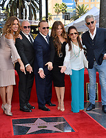 LOS ANGELES, CA. October 10, 2019: Lilli Estefan, Emilio Estefan, Tommy Mottola, Thalia Mottola, Gloria Estefan & David Foster at the Hollywood Walk of Fame Star Ceremony honoring Tommy Mottola.<br /> Pictures: Paul Smith/Featureflash