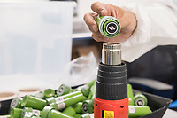 "A worker applies safety seals to dram bottles containing high-dose ""g-cap"" gel capsules at the production and packaging facility for Garden Remedies, a medical cannabis producer, in Fitchburg, Massachusetts, USA, on Fri., Feb. 22, 2019. The bottles have a variety of safety labels, including stickers that read ""Not safe for children"" and ""Contains THC"" in addition to other safety features."