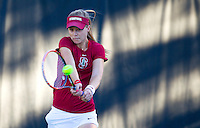 STANFORD, CA - MARCH 1, 2015--Stanford women's tennis player Caroline Doyle return the ball back to a CAL Berkley player during Sunday's match at  at the Taube Family Tennis Stadium.