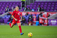 ORLANDO, FL - FEBRUARY 21: Adriana Leon #19 of the CANWNT dribbles the ball during a game between Argentina and Canada at Exploria Stadium on February 21, 2021 in Orlando, Florida.