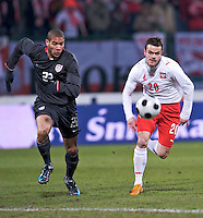 Oguchi Onyewu of the USA and Pawel Brozek of Poland. The United States defeated Poland 3-0 during an international friendly at Wisla Stadium in Krakow, Poland on March 26, 2008.