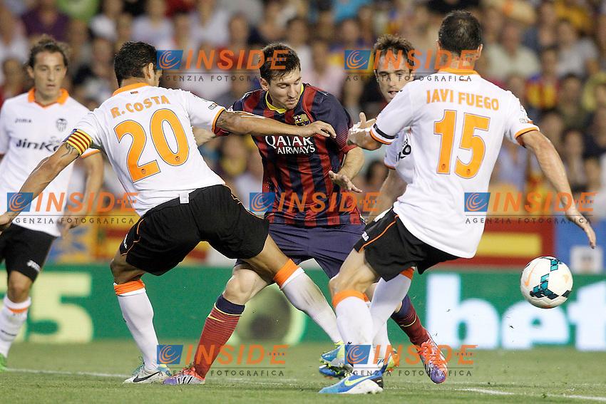 Valencia's Ricardo Costa (l) and Javi Fuego (r) and FC Barcelona's Leo Messi during La Liga match.September 1,2013. (ALTERPHOTOS/Acero) <br /> Football Calcio 2013/2014<br /> La Liga Spagna<br /> Foto Alterphotos / Insidefoto <br /> ITALY ONLY