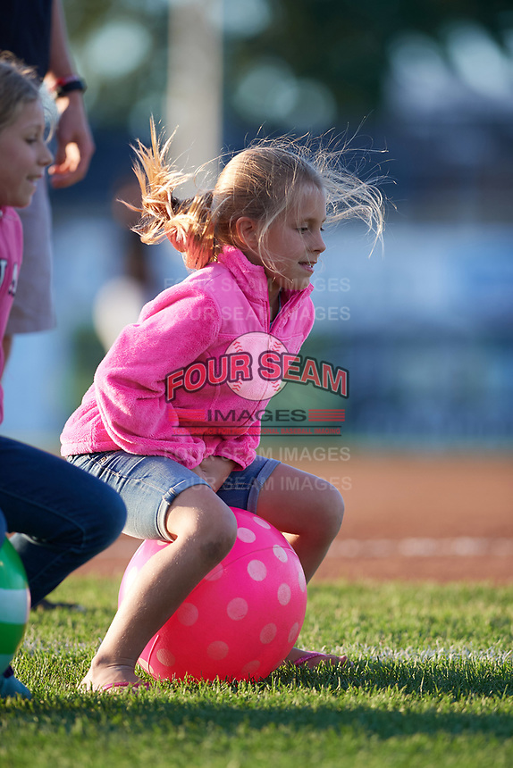 Young fans partake in a Batavia Muckdogs on field promotion during a game against the West Virginia Black Bears on August 5, 2017 at Dwyer Stadium in Batavia, New York.  Batavia defeated West Virginia 3-2.  (Mike Janes/Four Seam Images)
