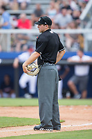 Home plate umpire Brandon Blome between innings of the Appalachian League game between the Princeton Rays and the Danville Braves at American Legion Post 325 Field on June 25, 2017 in Danville, Virginia.  The Braves walked-off the Rays 7-6 in 11 innings.  (Brian Westerholt/Four Seam Images)