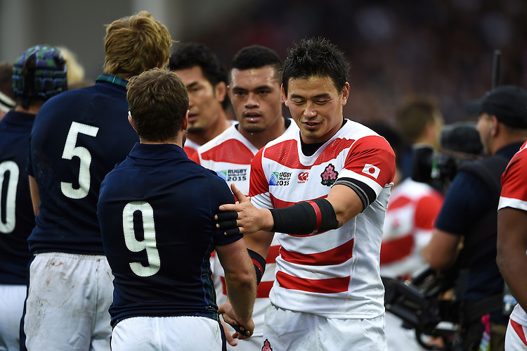 Ayumu Goromaru of Japan shakes hands with Greig Laidlaw of Scotland after the match. Rugby World Cup Pool B match between Scotland and Japan on September 23, 2015 at Kingsholm Stadium in Gloucester, England. Photo by: Patrick Khachfe / Stewart Communications