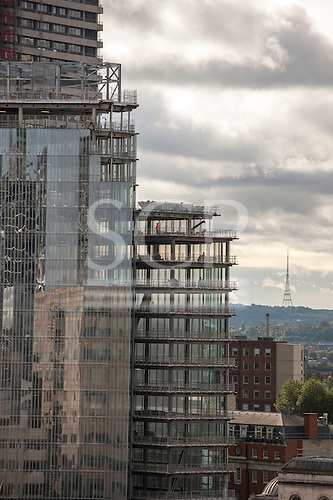 London, England. Reflection in a modern building under construction with the Crystal Palace television transmitter tower.