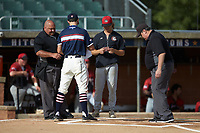 Umpires David Prim (left) and Randy Vestal (right) meet with High Point-Thomasville HiToms head coach Mickey Williard (left) and head coach Riley Nelson of the Deep River Muddogs prior to the start of their game at Finch Field on June 27, 2020 in Thomasville, NC.  The HiToms defeated the Muddogs 11-2. (Brian Westerholt/Four Seam Images)
