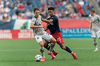 FOXBOROUGH, MA - JULY 25: Lassi Lappalainen #21 of CF Montreal attempts to control the ball as Brando Bye #15 of New England Revolution defends during a game between CF Montreal and New England Revolution at Gillette Stadium on July 25, 2021 in Foxborough, Massachusetts.