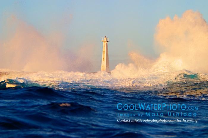 big ocean waves, pounding on lava rocks and lighthouse at Keahole Point, Kona Coast, Big Island, Hawaii, USA, Pacific Ocean