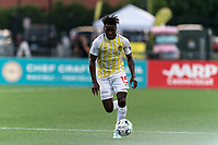 HARTFORD, CT - AUGUST 17: Temi Adesodun #15 of Charleston Battery brings the ball forward during a game between Charleston Battery and Hartford Athletic at Dillon Stadium on August 17, 2021 in Hartford, Connecticut.