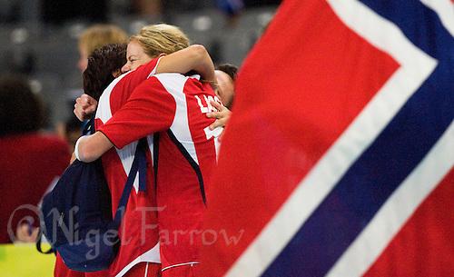 23 AUG 2008 - BEIJING, CHN - The Norwegian team celebrate beating Russia in the Womens Team Handball final - Beijing Olympics. (PHOTO (C) NIGEL FARROW) *** IOC RULES APPLY ON USAGE ***