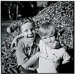 Two boys fool around at a lumber millEurope before the euro.