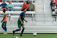 HARTFORD, CT - AUGUST 17: Thomas Janjigian #20 of Hartford Athletic brings the ball forward during a game between Charleston Battery and Hartford Athletic at Dillon Stadium on August 17, 2021 in Hartford, Connecticut.