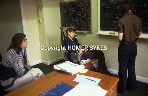 Stephen Hawking 1981 Cambridge University tutorial with students Nick Warner and Ian Moss. ( at blackboard )  Nick Warner is Professor of Theoretical High Energy Physics at the University of Southern California USA. Ian Moss is now Professor of Theoretical Cosmology at the University of Newcastle UK