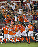 Houston Dynamo players Eddie Robinson (2), Wade Barrett (24), Brian Mullan (9), Craig Waibel (16), Adrian Serioux (51) and Paul Dalglish (8) celebrate with fans after a second Craig Waibel goal. Houston Dynamo tied  Colorado Rapids 3-3 at Robertson Stadium in Houston, TX on October 14, 2006.