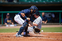 Montgomery Biscuits catcher Brett Sullivan (7) fields a throw to the plate as Tyler Heineman (8) slides home during a game against the Biloxi Shuckers on May 8, 2018 at Montgomery Riverwalk Stadium in Montgomery, Alabama.  Montgomery defeated Biloxi 10-5.  (Mike Janes/Four Seam Images)