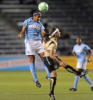 #12 Chioma Igwe of the Red Stars gets over # 8 Tiffany Weimer  of FC Gold Pride Red Stars for  the ball.   FC Gold Pride beat the Red Stars 1-0.