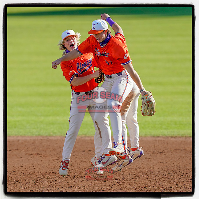 Outfielders from the Clemson Tigers Orange team celebrate their 3-1 win in Game 2 of the Orange-Purple intrasquad scrimmage series on Saturday, November 21, 2020, at Doug Kingsmore Stadium in Clemson, South Carolina. (Tom Priddy/Four Seam Images) #Clemson
